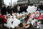 NEWTOWN, CT-17 December 2012-121712LW05 - Mourners pay tribute to the victims of the shooting at Sandy Hook Elementary School at the site of a makeshift memorial in Newtown at the corner of Washington Avenue and Church Hill Road Monday. Laraine Weschler