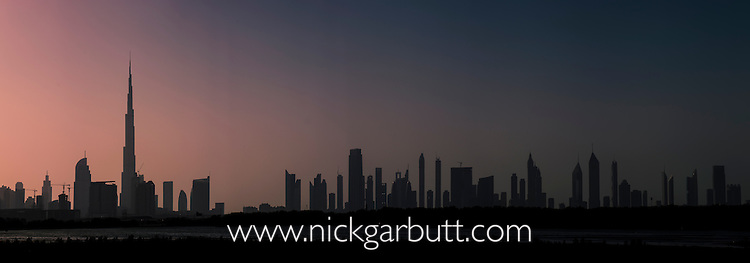 Sunset at Ras Al Khor Wildlife Sanctuary (Ramsar site), with the Dubai skyline in the background including the Burj Khalifa (the world's tallest building at 829.8m). Dubai, United Arab Emirates.
