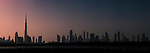 Sunset at Ras Al Khor Wildlife Sanctuary (Ramsar site), with the Dubai skyline in the background including the Burj Khalifa (the world's tallest building at 829.8m). Dubai, United Arab Emirates.
