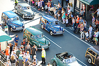 Pictured: Saturday 17 September 2016<br /> Re: Roald Dahl's City of the Unexpected has transformed Cardiff City Centre into a landmark celebration of Wales' foremost storyteller, Roald Dahl, in the year which celebrates his centenary.<br /> Morris Minors are driven down Westgate Street.