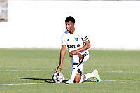 RICHMOND, VA - SEPTEMBER 30: Dre Fortune #8 of North Carolina FC takes a knee during a moment of silence for the victims of systemic violence before a game between North Carolina FC and New York Red Bulls II at City Stadium on September 30, 2020 in Richmond, Virginia.