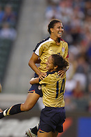 USA's Abby Shannon Boxx jumps into the arms of teammate Stephanie Lopez after scoring a goal against Finland. The USA women's national team defeated Finland 4-0 at the Home Depot Center in Carson, CA, on August 25, 2007. (Photo by Matt A. Brown/ISIphotos.com)