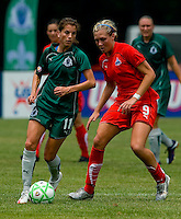 Washington Freedom midfielder Allie Long (9) and St. Louis Athletica forward Angie Woznuk (11) during a WPS match at Anheuser-Busch Soccer Park, in Fenton, MO, June 20 2009. Washington  won the match 1-0.