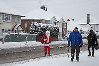 A father Christmas gives cheer to passers by<br /> Weather - the Snowfall in High Wycombe, England on 10 December 2017. Photo by Andy Rowland.