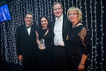 © Joel Goodman - 07973 332324 . 05/03/2015 .  Midland Hotel , Manchester , UK . L-R Eamonn O'Neill , winner Sally Harrison QC of St John's Buildings , sponsor ( Advanced Legal ) and Louise Straw . Barristers' Chambers of the Year . The Manchester Legal Awards 2015 . Photo credit : Joel Goodman