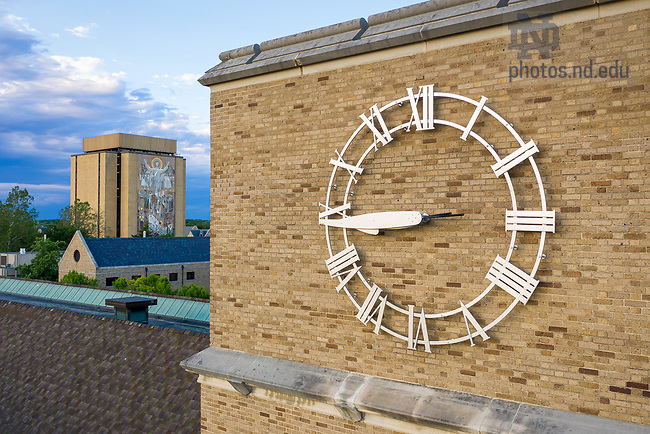 June 11, 2020; O'Shaughnessy Hall clock and Hesburgh Library (Photo by Matt Cashore/University of Notre Dame)