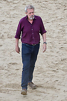 Pictured: Hugh Laurie. Friday 18 June 2021<br /> Re: Film set with a scene being filmed with Hugh Laurie as a director at Three Cliffs Bay in the Gower Peninsula, Wales, UK.