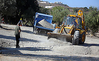 FAO JANET TOMLINSON, DAILY MAIL PICTURE DESK<br /> Pictured: A digger and a tipper lorry used to excavate part of the field in Kos, Greece. Monday 03 October 2016<br /> Re: Police teams led by South Yorkshire Police, searching for missing toddler Ben Needham on the Greek island of Kos have moved to a new area in the field they are searching.<br /> Ben, from Sheffield, was 21 months old when he disappeared on 24 July 1991 during a family holiday.<br /> Digging has begun at a new site after a fresh line of inquiry suggested he could have been crushed by a digger.