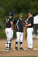 Statesville Owls head coach Michael Bonifay has a meeting on the mound with relief pitcher Gordon Soffel (14) (Erskine College) during the game against the High Point-Thomasville HiToms at Finch Field on July 19, 2020 in Thomasville, NC. The HiToms defeated the Owls 21-0. (Brian Westerholt/Four Seam Images)