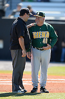 Siena Saints head coach Tony Rossi (40) talks with an umpire before a game against the Central Florida Knights at Jay Bergman Field on February 16, 2014 in Orlando, Florida.  UCF defeated Siena 9-6.  (Mike Janes/Four Seam Images)