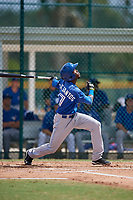 Toronto Blue Jays shortstop Luis De Los Santos (17) follows through on a swing during an Instructional League game against the Pittsburgh Pirates on October 13, 2017 at Pirate City in Bradenton, Florida.  (Mike Janes/Four Seam Images)