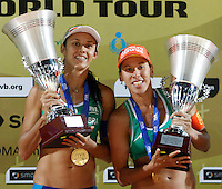 Brazil's  Taiana de Souza Lima, right, and Talita Antunes da Rocha, hold trophies at the end of the women's final match between Brazil and United States at the Beach Volleyball World Tour Grand Slam, Foro Italico, Rome, 23 June 2013. Brazil defeated United States 2-1.<br /> UPDATE IMAGES PRESS/Isabella Bonotto