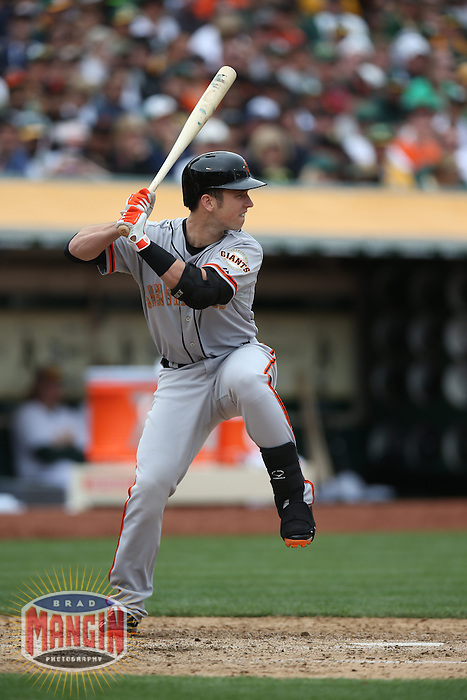 OAKLAND, CA - MAY 27:  Buster Posey #28 of the San Francisco Giants bats against the Oakland Athletics during the game at O.co Coliseum on Monday May 27, 2013 in Oakland, California. Photo by Brad Mangin
