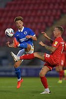 Jack Spong of Brighton & Hove Albion (U23s) and Jordan Maguire-Drew of Leyton Orient battle for possession during the EFL Trophy behind closed doors match between Leyton Orient and Brighton & Hove Albion Under 21s at the Matchroom Stadium, London, England played without supporters able to attend due to ongoing covid-19 government guidelines on 8 September 2020. Photo by Vince  Mignott.