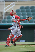 Hagerstown Suns catcher Israel Pineda (20) tracks a pop fly during the game against the Kannapolis Intimidators at Kannapolis Intimidators Stadium on August 26, 2019 in Kannapolis, North Carolina. The Suns defeated the Intimidators 4-1. (Brian Westerholt/Four Seam Images)