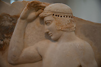 Athens, museo archeologico. Bassorilievo votivo raffigurante un atleta  Votive relief (Sounion, Temple of Athena) self-crowning athlete (his wreath was made of metal and fitted to the drilled holes visible around th ehead)  ca 460 BC
