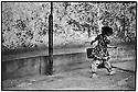 Uzbekistan - Tashkent - Little girl carrying the litter in Old Tashkent.