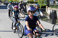 Parker Forrester, a fourth grade student at J.B. Hunt Elementary School, rides with both fourth and fifth grade students and staff members Friday, April 30, 2021, back to the school from Shiloh Square in Springdale. The students were participating in an annual Bike Field Trip. Check out nwaonline.com/210501Daily/ and nwadg.com/photos for a photo gallery.<br /> (NWA Democrat-Gazette/David Gottschalk)