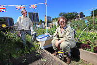 Sharon Bassey on the right and Liz Gill in the Stuart Road allotments where Sharon started a garden that became an apiary. Today, Sharon is leading a group of seven people through the apiary. Sharon works with children with learning difficulties and Liz repairs clocks.