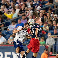 FOXBOROUGH, MA - AUGUST 18: Steven Birnbaum #15 of D.C. United and Adam Buksa #9 of New England Revolution battle for head ball during a game between D.C. United and New England Revolution at Gillette Stadium on August 18, 2021 in Foxborough, Massachusetts.
