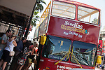 People getting on a Hop On Hop Off Starline Tour Bus on Hollywood Blvd in Hollywood, Los Angeles, CA