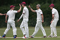 Ian Belchamber of Brentwood celebrates with his team mates after taking the wicket of Craig Perrin during Brentwood CC (bowling) vs Harold Wood CC, Hamro Foundation Essex League Cricket at The Old County Ground on 12th June 2021