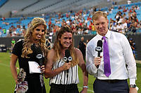 CHARLOTTE, NC - OCTOBER 3: Fox Sports hosts Heather O'Reilly and Alexi Lalas during a game between Korea Republic and USWNT at Bank of America Stadium on October 3, 2019 in Charlotte, North Carolina.