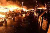 Barricades built on Maidan square in the last three months are now burning into flames under the repressive assault of the police .  Kiev, Ukraine