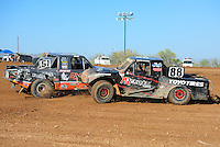Apr 17, 2011; Surprise, AZ USA; LOORRS driver Austin Kimbrell (88) gestures Ryan Beat (51) as they spin during round 4 at Speedworld Off Road Park. Mandatory Credit: Mark J. Rebilas-