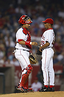 Jose Molina and Ramon Ortiz of the Anaheim Angels during a 2003 season MLB game at Angel Stadium in Anaheim, California. (Larry Goren/Four Seam Images)