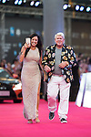 John Daly and his partner walks the Red Carpet event at the World Celebrity Pro-Am 2016 Mission Hills China Golf Tournament on 20 October 2016, in Haikou, China. Photo by Victor Fraile / Power Sport Images