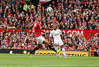 Pictured L-R: Chris Smalling of Manchester United closely marked by Wayne Routledge of Swansea. Saturday 16 August 2014<br />
