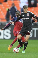 Washington, D.C.- March 29, 2014. Conor Doyle (30) of D.C. United shields the ball against Patrick Nyarko of the Chicago Fire. The Chicago Fire tied D.C. United 2-2 during a Major League Soccer Match for the 2014 season at RFK Stadium.