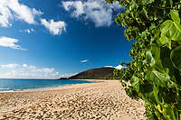 A clear day at Makena Beach, Maui, with visitors enjoying the far end of the beach.
