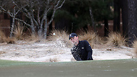 PINEHURST, NC - MARCH 02: Alex Fitzpatrick of Wake Forest University chips out of a bunker and onto the green on the 17th hole at Pinehurst No. 2 on March 02, 2021 in Pinehurst, North Carolina.
