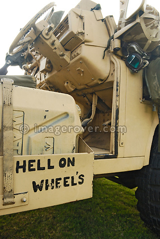 """Inscription """"Hell on Wheels"""" found on an army Land Rover 110 Pink Panther.  Exhibited at Dunsfold Collection of Land Rovers 2006 open day, Dunsfold, Surrey, England, UK.  --- No releases available. Automotive trademarks are the property of the trademark holder, authorization may be needed for some uses."""