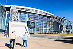 Fans prepare to enter the Choctaw Casino Iron Cowboy bull riding event, at the AT & T stadium in Arlington, Texas.