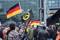 """Etwa 2.000 rechtsradikale Menschen demonstrierten am Samstag den 12. Maerz 2016 in Berlin unter dem Motto """"Merkel muss weg!"""" gegen Angela Merkel, gegen Fluechtlinge und fuer """"Das deutsche Vaterland"""".<br /> Bis auf wenige Ausnahmen waren angereisten Teilnehmer Neonazis und Hooligans, NPD-, Pediga- und AfD-Mitglieder.<br /> Aufgerufen zu dem Aufmarsch hatten die Hooligan-Gruppen """"Buendnis fuer Deutschland"""" und """"Buendnis fuer Berlin"""".<br /> Im Bild: Es werden von Teilnehmern Deutschlandfahnen, eine Fahne mit Eisernem Kreuz und der Inschrift """"Gott mit uns"""" und eine Fahne der Neonaziorganisation """"Die Identitaeren"""" hochgehalten.<br /> 12.3.2016, Berlin<br /> Copyright: Christian-Ditsch.de<br /> [Inhaltsveraendernde Manipulation des Fotos nur nach ausdruecklicher Genehmigung des Fotografen. Vereinbarungen ueber Abtretung von Persoenlichkeitsrechten/Model Release der abgebildeten Person/Personen liegen nicht vor. NO MODEL RELEASE! Nur fuer Redaktionelle Zwecke. Don't publish without copyright Christian-Ditsch.de, Veroeffentlichung nur mit Fotografennennung, sowie gegen Honorar, MwSt. und Beleg. Konto: I N G - D i B a, IBAN DE58500105175400192269, BIC INGDDEFFXXX, Kontakt: post@christian-ditsch.de<br /> Bei der Bearbeitung der Dateiinformationen darf die Urheberkennzeichnung in den EXIF- und  IPTC-Daten nicht entfernt werden, diese sind in digitalen Medien nach §95c UrhG rechtlich geschuetzt. Der Urhebervermerk wird gemaess §13 UrhG verlangt.]"""