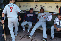 OAKLAND, CA - JULY 30:  Joe Mauer #7, manager Ron Gardenhire #35, and Delmon Young #21 of the Minnesota Twins gets ready in the dugout before the game against the Oakland Athletics at the Oakland-Alameda County Coliseum on July 30, 2011 in Oakland, California. Photo by Brad Mangin