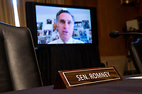 """United States Senator Mitt Romney (Republican of Utah), participating remotely, directs a question to Mark A. Morgan, acting commissioner of the U.S. Customs and Border Protection, during the US Senate Homeland Security and Governmental Affairs Committee hearing titled """"CBP Oversight: Examining the Evolving Challenges Facing the Agency,"""" in Dirksen Senate Office Building on Thursday, June 25, 2020.<br /> Credit: Tom Williams / Pool via CNP/AdMedia"""