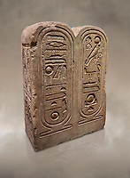 "Ancient Egyptian architectonic element of the temple of Aten, Karnak, limestone, New Kingdom 18th Dynasty (1353-1336 BC). Egyptian Museum, Turin. <br /> This crystaline block from the riugn of Amenhoptep IV was part of the railing of the temple of Aten in Karnak. It is os a double form cartouche, which usually enclose the name of the king. Here insted, it contains the names of the sun disk Aten, the one god of King Akhenaten : ""Ra-Harakhty rising in the Horizon"" ""in the name as the light which is in Aten"". The name of the king is carved on the sides. The objects is therefore a links god with the pharoah. Drovetti collection Cat 1378"