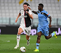 Calcio, Serie A: Juventus - Lazio, Allianz Stadium, July 20, 2020.<br /> Juventus' Adrien Rabiot (l) n action with Lazio's Bastos (r) during the Italian Serie A football match between Juventus and Lazio at the Allianz stadium in Turin, July 20, 2020.<br /> UPDATE IMAGES PRESS/Isabella Bonotto