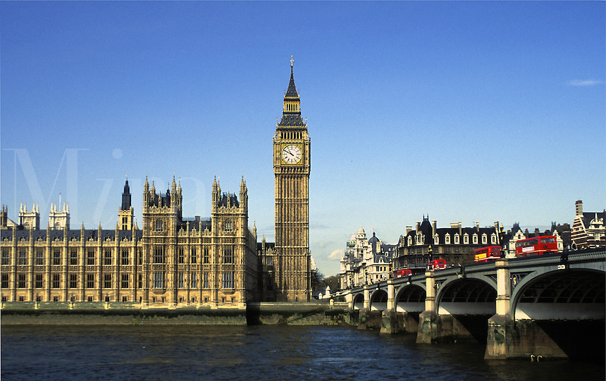 London buses crossing bridge by Parliament. Parliament and London buses.