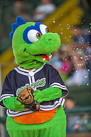 20 August 2015: Vermont Lake Monsters Mascot Champ holds a player's glove in jest and gets water tossed at him prior to a game against the Tri-City ValleyCats at Centennial Field in Burlington, Vermont. The Stedler Division-leading ValleyCats defeated the Lake Monsters 5-2 in NY Penn League action. Mandatory Credit: Ed Wolfstein Photo *** RAW Image File Available ****