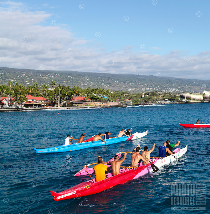 Paddlers take out their outrigger canoes during practice in Kailua Bay, as seen from the Kailua-Kona pier, Hawai'i Island.
