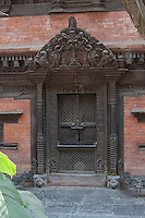 Kathmandu, Nepal.  Traditional Carved Wood Door and Windows now Installed in Dwarika's Hotel.  This is one of Kathmandu's finest and most interesting hotels, which has rescued thousands of original doors and windows from abandoned houses, to incorporate them into the hotel's construction.