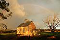 Old church and rainbow