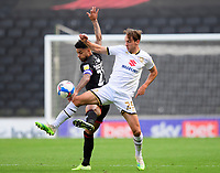 Lincoln City's Liam Bridcutt battles with Milton Keynes Dons' Callum Brittain<br /> <br /> Photographer Chris Vaughan/CameraSport<br /> <br /> The EFL Sky Bet League One - Milton Keynes Dons v Lincoln City - Saturday 19th September 2020 - Stadium MK - Milton Keynes<br /> <br /> World Copyright © 2020 CameraSport. All rights reserved. 43 Linden Ave. Countesthorpe. Leicester. England. LE8 5PG - Tel: +44 (0) 116 277 4147 - admin@camerasport.com - www.camerasport.com