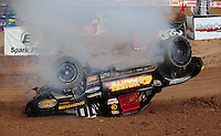 Dec. 10, 2010; Chandler, AZ, USA;  Smoke comes from the truck of LOORRS pro two unlimited driver Greg Adler after flipping over during qualifying for round 15 at Firebird International Raceway. Mandatory Credit: Mark J. Rebilas-