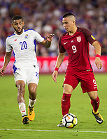 Orlando, FL - Friday Oct. 06, 2017: Aníbal Godoy, Bobby Wood during a 2018 FIFA World Cup Qualifier between the men's national teams of the United States (USA) and Panama (PAN) at Orlando City Stadium.